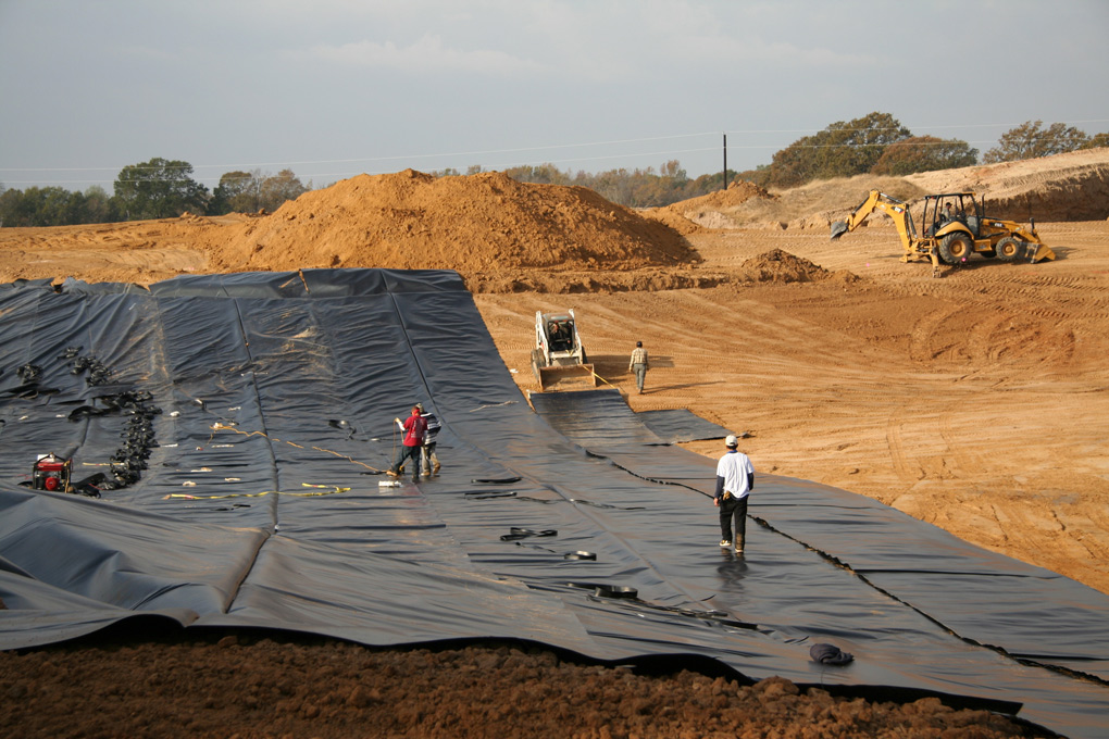 Central Texas geomembrane plastic lake liner installation on 4 acre lake.