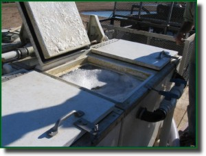 Each transport tank holds a different fish species and is inspected prior to release in the fishing lake.