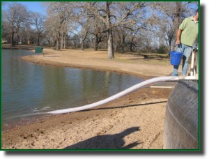 Discharge hose on the hatchery truck pumps the new fish into the fishing lake.