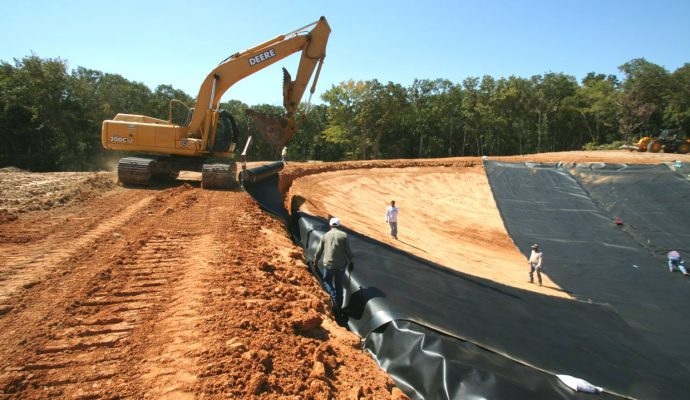 Plastic lake liner installation on large Central Texas recreation lake.