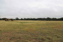 The site was an open field with a gentle slope.