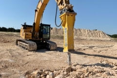 Unfortunately the D8 dozer was not able to sufficiently rip the rock so a Caterpillar 336 excavator with a hydraulic hammer was brought it.  The hammer was ore efficient and did the job well but it was very slow as compared to ripping.