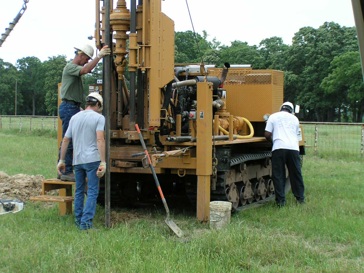 Soil testing with a core drilling machine to verify lake building location.